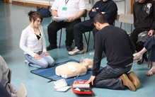 Students being instructed in the use of the defibrillator