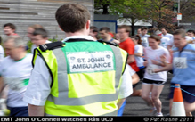 St John Ambulance member watching a race